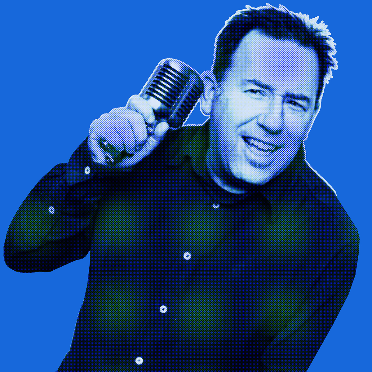 Blue-filtered picture of a man smiling and holding a microphone to his ear