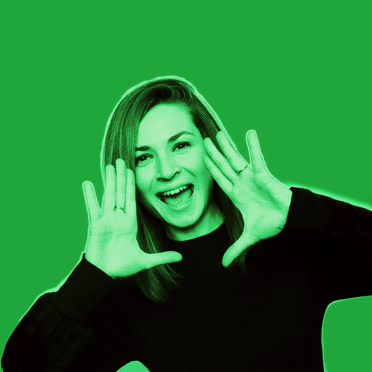 Green-filtered picture of woman smiling and holding both hands to the side of her face