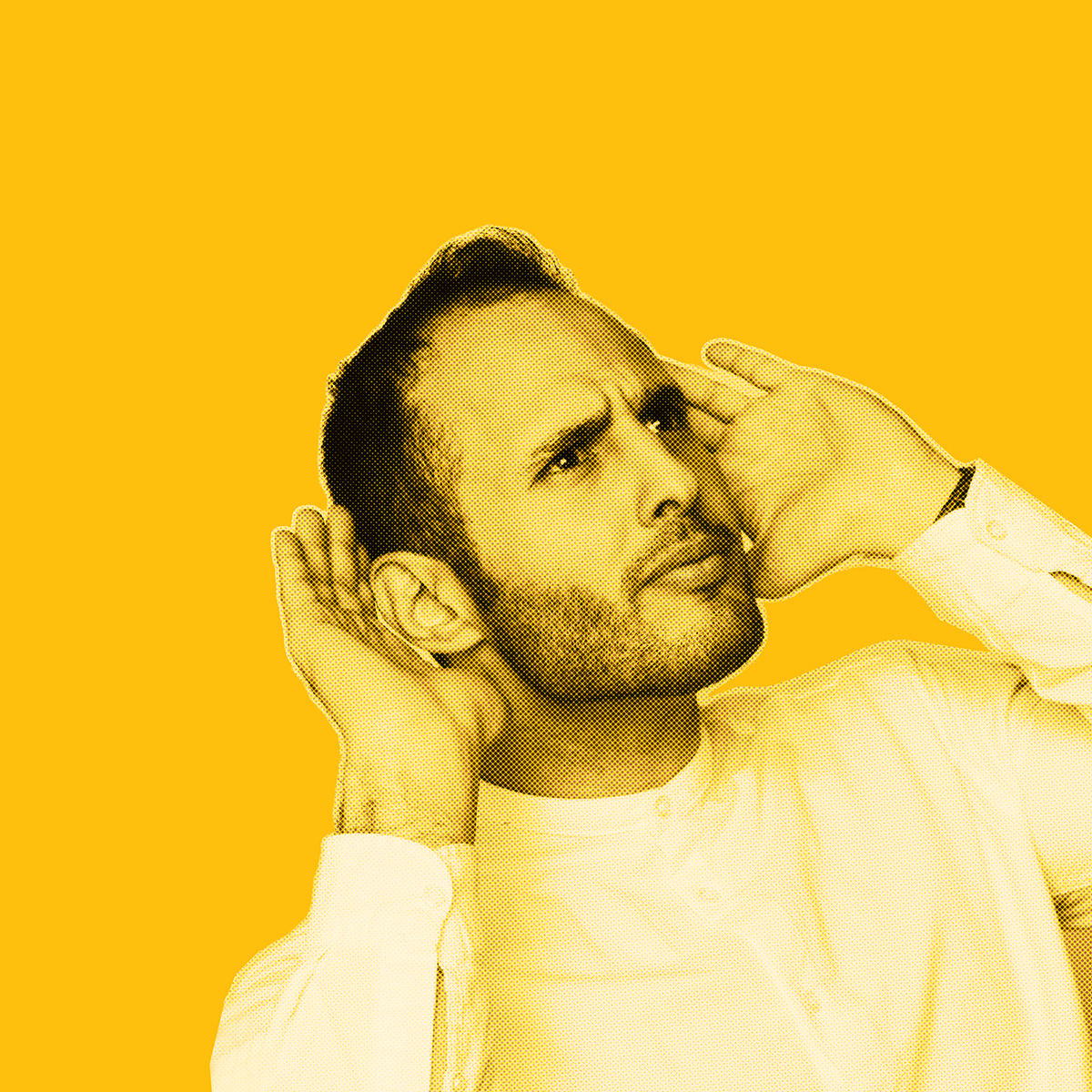 Yellow-filtered picture of man looking to the side holding his hands behind his ears