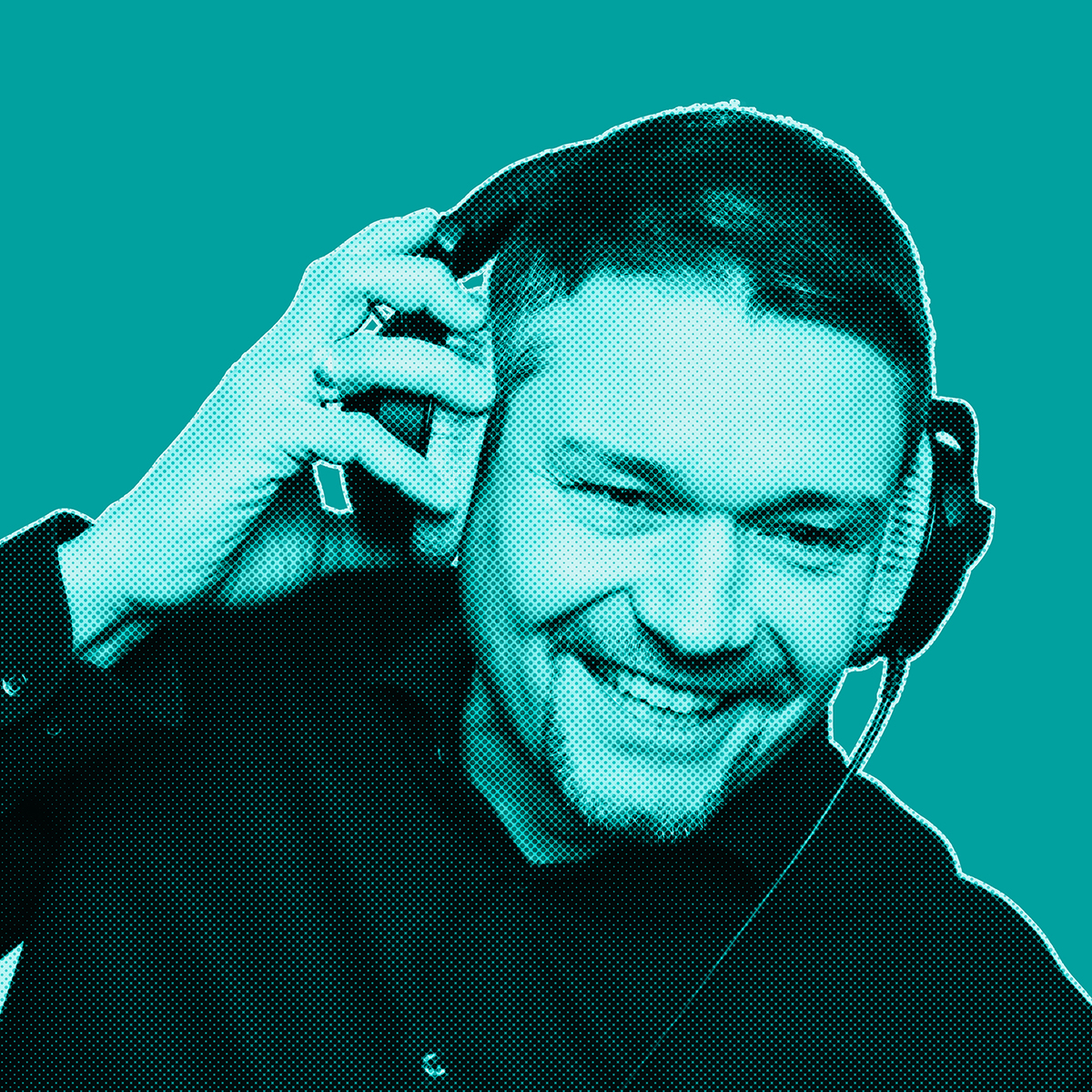 Turquoise-filtered picture of man smiling and wearing headphones, holding them with his right hand