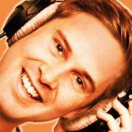 Orange-filtered portrait of a man smiling wearing headphones